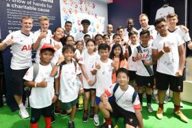 Moussa Sissoko (back row, third from right) and his Tottenham Hotspur teammates at an AIA sponsor's event at the Singapore Sports Hub's OCBC Square on Saturday.