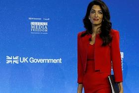 Amal Clooney schools celebs in style