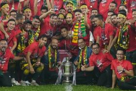 Coach Aidil Sharin (second row, centre, with scarf) celebrating with the Kedah squad after their win over Perak in the Malaysian FA Cup.