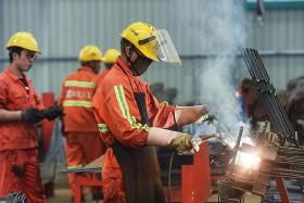 China's factory activity shrinks for third straight month