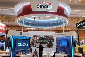 Analysts shift Singtel's outlook to negative