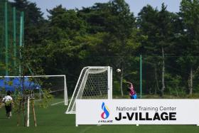 Children play football at the J-Village during a media tour in Naraha, Fukushima prefecture on Aug 2, 2019.