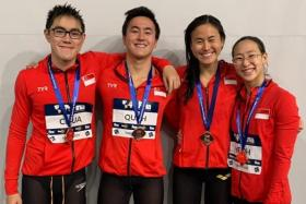 (From left) Darren Chua, Quah Zheng Wen, Quah Ting Wen and Cherlyn Yeoh after their record-breaking swim in the 4x100m freestyle relay.