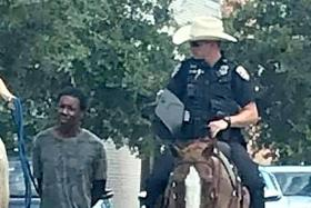 Photo of cops leading black man by a rope in Texas sparks outrage