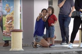 Joscelin Yeo (left) and her son Michael in a scene from On The Red Dot's Old Enough!