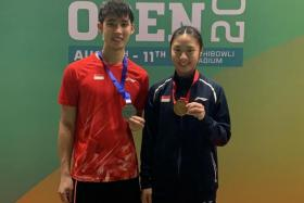 Singapore's Loh Kean Yew (left) and Yeo Jia Min with their medals.