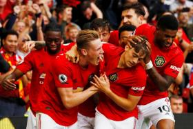 Manchester United's Daniel James (centre) celebrates scoring their fourth goal with Scott McTominay, Marcus Rashford and teammates.