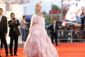In three shaken U.S. cities, Lady Gaga tries to channel 'fury into hope'