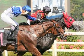 Grand Koonta surging up on the inside to beat Elite Power in the $85,000 Class 2 race over 1,200m on Sunday.