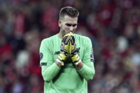 Liverpool goalkeeper Adrian will be assessed before the Southampton match.