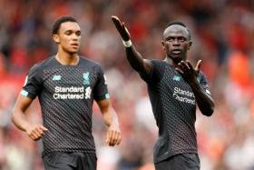 Sadio Mane (right) celebrates after giving Liverpool the lead just before half-time.