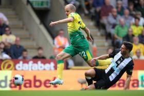 Norwich City striker Teemu Pukki getting past Newcastle United defender Fabian Schar.