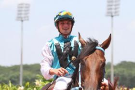 French jockey Louis-Philippe Beuzelin is all smiles aboard his first Singapore winner Universal Empire.