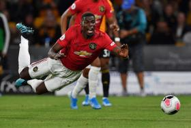 Manchester United's Paul Pogba earns a penalty after being fouled by Wolves' Conor Coady in the box. But Pogba subsequently missed from the spot.