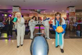 The remake of ABBA, made up of (front, from left) SBF President Mrs Jessie Phua and her husband Mr Jimmy Phua, (back, from left) vice-president Dr Valerie Teo and honorary secretary Mr Delane Lim taking part in the fun bowl.