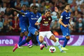 Aston Villa's Douglas Luiz in action with Everton's Moise Kean.