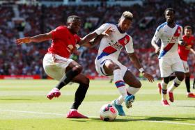 Crystal Palace's Patrick van Aanholt vying for the ball with Manchester United's Aaron Wan-Bissaka.