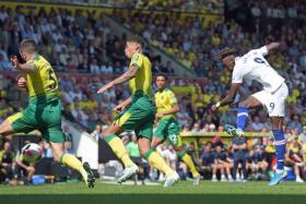 Chelsea's Tammy Abraham firing in the winning goal in their 3-2 victory over Norwich City.