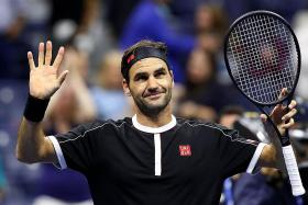 Roger Federer overcomes scare from qualifier in US Open first round