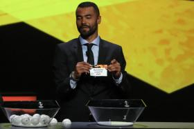 Former England international Ashley Cole holding a slip with Manchester United's name during the Europa League draw.