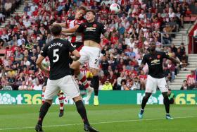 Southampton's Jannik Vestergaard heading in their equaliser despite the challenge of Manchester United defender Victor Lindelof.