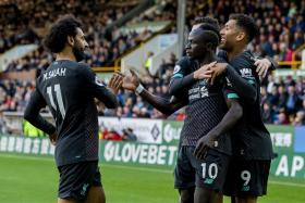 Mohamed Salah (left) joining in the celebrations after Sadio Mane scored Liverpool's second goal.