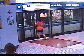 What is the real reason woman forced open MRT platform doors?