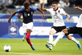 France's Kingsley Coman (left) opening the scoring against Albania.