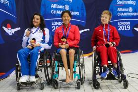 Singapore's gold medallist in the 50m backstroke (S2) event - Yip Pin Xiu (centre), with second-placed Angela Procida of Italy (left) and bronze winner Aly van Wyck-Smart of Canada.