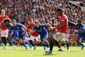 Marcus Rashford putting away an eighth-minute penalty for Manchester United in their game against Leicester City.