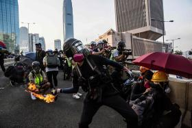 Chaos returns to HK as police fire tear gas, water cannons