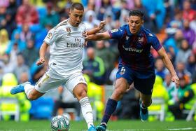 Real Madrid forward Eden Hazard fans the flames with fan comment