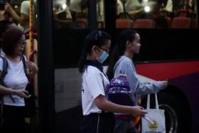 A student from Nanhua Primary School wearing a mask while walking to school on Sept 16, 2019.