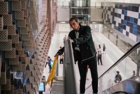 SBS Transit staff member rescues boy hanging off moving escalator