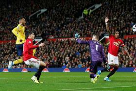 Pierre-Emerick Aubameyang (left) scoring Arsenal's equaliser against Manchester United.