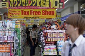 Japan proceeds with twice-delayed sales tax hike