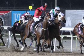 Pindus (in white) battling out with the eventual winner, Lim's Knight, on his debut race on Sept 6.