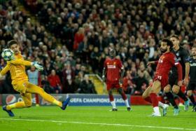 Mohamed Salah scoring Liverpool's winner.