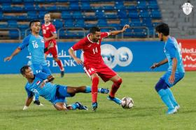 (From left, in blue) Singapore's Hami Syahin, Fareez Farhan and Yasir Hanapi keeping a close watch on a Jordanian opponent.