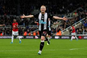 Matthew Longstaff celebrates after scoring against Manchester United.