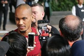 Roberto Firmino, Fabinho hold court on arrival in Singapore