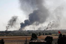 Turkey says more than 100 militants killed; more than 60,000 flee