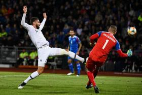 France's Olivier Giroud (left) challenging for the ball with Iceland goalkeeper Hannes Halldorsson.