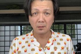 A selfie of the writer wearing the McDonald's pyjamas.