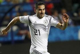 Germany show can-do spirit after Emre Can's red card