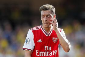 Arsenal midfielder Mesut Oezil: Stop pointing the finger at me