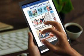 The Berita Harian News Tablet is the newspaper's latest product that enhances the reading experience with functions such as zoom capability, instant news-clipping sharing and a 14-day news archive.