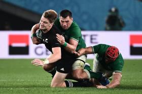 New Zealand's fly-half Jordie Barrett is tackled during their quarter-final win over Ireland.