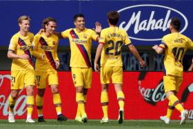 (From left) Frenkie de Jong, Antoine Griezmann and Luis Suarez celebrating the Frenchman's opener with Sergi Roberto and Lionel Messi.