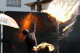 HK protesters battle cops, torch hundreds of shops
